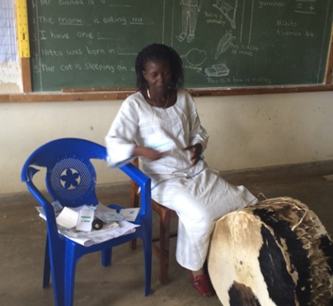 Judith Phiri with tools she uses to help teach her hearing impaired students.