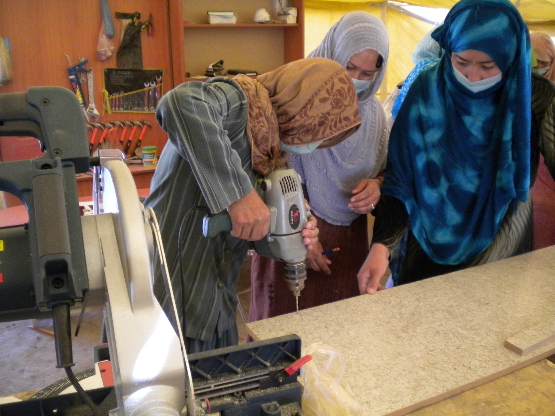 Women in tradition clothing in Afghanistan learning carpentry skills