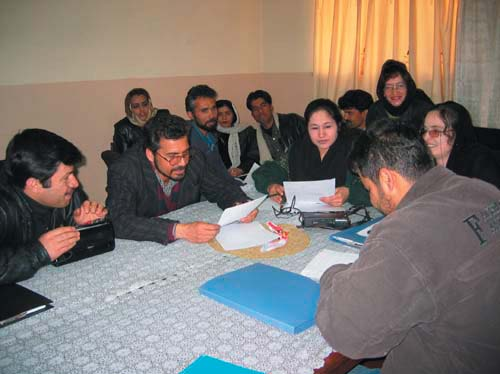 Budding playwrights review their scripts at the USAID Writing for Radio Workshop in Kabul.