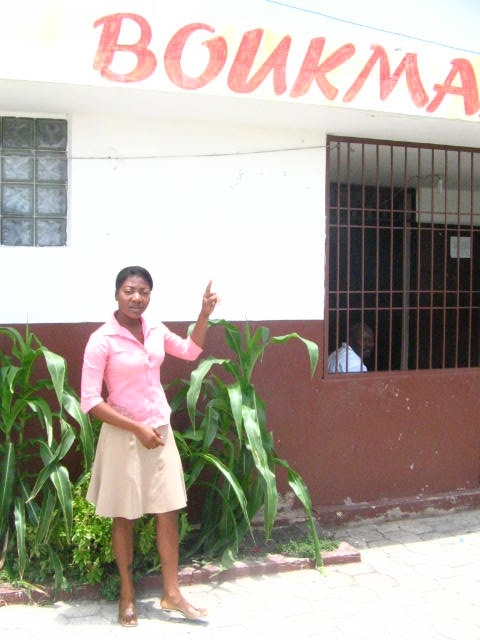 Cité Soleil resident Fabienne Viltis, standing in front of the community radio station where she hosts a show.