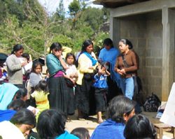 "Dominga Hernández Ruiz, in the center wearing a yellow top, meets with her ""solidarity group"" at an AlSol training meeting."