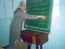 Abeer Rahhal uses skills learned in her training to teach other women about health