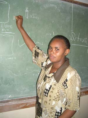 Nursing teacher Winfrida Kwesha lectures at the Kasama School of Nursing, which provides an incentive package to support them.